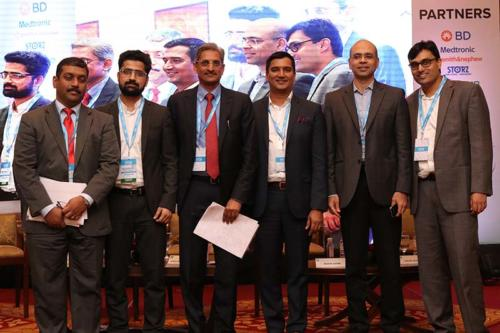Group photo as session ends.From left to right: Mr Badhri Iyengar, Managing Director, Smith & Nephew India, Mr Mohammad Ameel, Senior Consultant, NHSRC, Mr Pavan Mocherla, Managing Director, Becton Dickinson, Mr Shravan Subramanyam, Managing Director, Roche, Mr Rohit Sathe, President, Philips Health Systems, India and Dr Vidur Mahajan, Associate Director, Mahajan Imaging